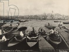 Men sit in bobbing boats docked in the Golden Horn inlet, Turkey, 1922 (b/w photo)  Image ID: NGE 420754