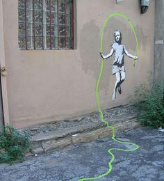 stencil art girl jumping green rope
