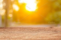 Wood table top on sun light by Pushish Images on @creativemarket