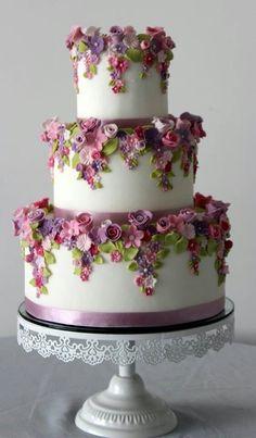 Flower laden 3-tiered wedding cake http://weddingmusicproject.bandcamp.com/album/wedding-hymns-2