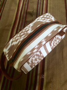 Fresco Fabrics Camel & White Ikat Dopp Kit. www.frescofabrics.com Guatemalan Textiles, Dopp Kit, Leather Handle, Ikat, Fresco, Suede Leather, Camel, Fabrics, Handmade