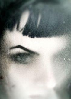 ...through a glass darkly...