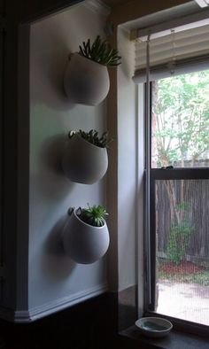 succulent planters - asker pots from ikea. -that you could paint or decorate...:)