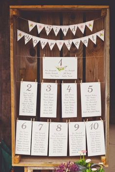 creative wedding seating charts made of big wooden crate