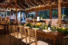 Wedding reception with long farmhouse trestle tables under twinkle lights at Paradise Cove