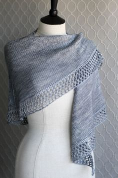 Baskerville by Beth Kling is a generously-proportioned triangular shawl with an elongated shape made up of a central textured panel flanked by stockinette side panels. Knit yours with lovely Anzula Cricket yarn. #kitterlykits