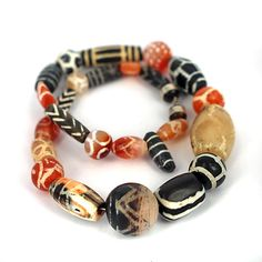Ancient world beads -mixed collection of very old decorated carnelian & agate stone beads.