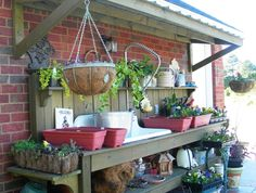 Potting Bench With Sink | There's even a metal roof over the bench to provide some shade for ...