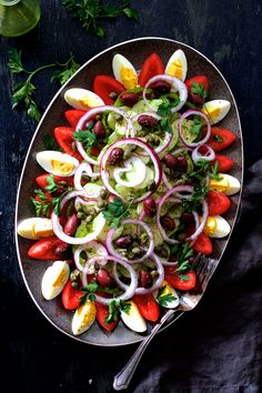 Full of fresh, crunchy vegetables, olives, capers and drizzled with a simple red wine vinaigrette, Tunisian Salad Platter (or Assiette Tunisienne) makes an impressive presentation for a buffet!