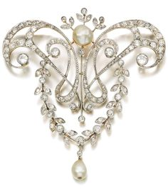 A natural pearl and diamond brooch, early 20th century. The brooch of foliate and scroll design, set with two natural pearls and circular, single-cut and cushion-shaped diamonds.