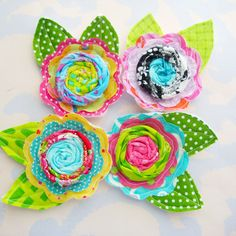 Rolled Fabric Flowers with Leaves- love the colors