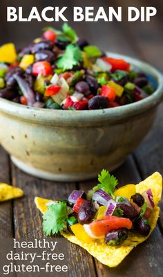 Want a quick and easy black bean dip for tailgates, picnics and cookouts? This simple, healthy recipe is the best. It's naturally dairy free, gluten free and great with crunchy tortilla chips. My family devours this tangy, zesty snack. We also use it as a black bean salsa for grilled chicken, pork and seafood or as a topping for tacos and tostadas. Make some for Cinco De Mayo! Healthy Bean Dip Recipe, Bean Dip Recipes, Healthy Gluten Free Recipes, Black Bean Dip, Black Bean Salsa, Black Beans, Vegan Appetizers, Easy Appetizer Recipes, Snack Recipes