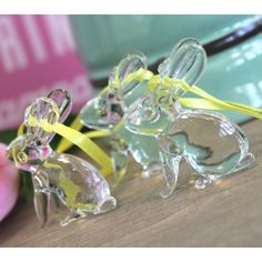 Bounce into Easter with our set of glass bunny decorations, suspended from a yellow ribbon they will dance merrily in the breeze. Why not hang on a painted branch from the garden as an Easter tree or group together with flowers as a table center piece. A wonderful gift alternative to the usual chocolate treat.    Find them at:  http://www.pasttimes.com/gift_finder/by_occasion/easter_gifts/set_of_3_hanging_glass_bunnies-870153.htm
