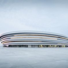 Our #ProjectOfTheDay is Arena du Pays d'Aix by Auer Weber and Gulizzi/ The new handball arena is made of metallic ellipses stacked like layered contours and at first look, it seems there's no front or back since each side of the facade is treated equally/ Post your best stucco projects this week with hashtags #Architizer and #Stucco and we'll share our favorites