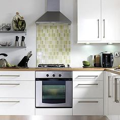 Design: Kitchen-compare.com - BQ IT Gloss White Slab. This is the style cabinet I want. I also like the hardware.