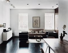 Dark floors, white walls, heightens the room.