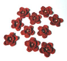 100% Cotton crochet flowers    Quantity: 10 pieces    Colors: red    Diameter: 32mm    These 100% cotton flowers, 2 layered red petals with