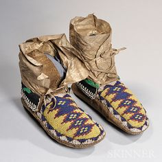 Plains Cree Beaded Hide Man's Moccasins, c. last quarter century, with remnant cloth cuffs with beaded stepped cross design on a yellow background Native American Moccasins, Native American Clothing, Native American Crafts, Native American Design, Native American Artifacts, Native American Beadwork, American Indian Art, Native American Indians, Moccasin Boots