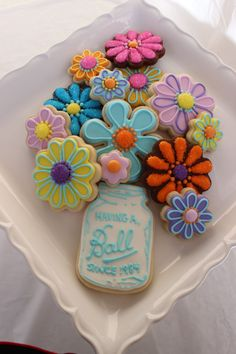 "Colourful flower and number cookies - ""Gypsy sister inspired"" cookie mason jar arrangement. Not 100% sure who's the original creator of the mason jar cookie idea but it is not mine."