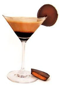 The Sweetest Temptations: Reese's Peanut Butter Cup Martini 1 1/2 oz. Chocolate Vodka 1 oz. Peanut Rum 3/4 oz. Chocolate liqueur 1/2 oz. creme  Squeeze chocolate syrup into the bottom of a martini glass.  Mix ingredients into a shaker with ice and shake, shake, shake!  Strain into glass and garnish with a Reese's cup.  Serve Immediately.