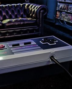Nintendo controller coffee table....I can think of quite a few guys who would love this. Would look great in a man cave!