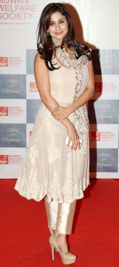 Urmila Matondkar looked slim and trim in a golden Indo-western number by her favourite designer Manish Malhotra at the Mijwan Fashion Show.