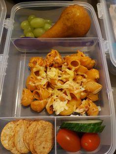Chicken pasta, fruits, veggies and rice crackers.