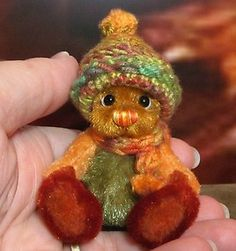 **Beth Franco Bears** - Pumpkin is 2 1/2 inches sitting and 2 3/4 inches tall.
