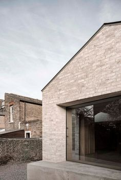 To achieve the space required by the owners of Kew House, the architects proposed an extension comprising a pair of chamfered forms with pitched roofs that intersect to create a complex collision of planes.