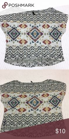 Sheer tribal sweater Comes down around the waist. Little high low. Sheer. Preloved but great condition. Polyester and spandex Sweaters