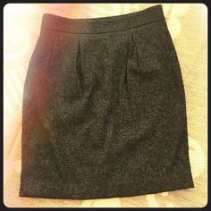 Ann Taylor black wool blend skirt Super cute skirt that has a subtle silvery chevron type of design beneath the black. This skirt is extremely fuzzy all over. Since it's black you can't see it from far away but up close it's obvious over the entire fabric. Material is a wool blend. Size 8. Ann Taylor Skirts Midi