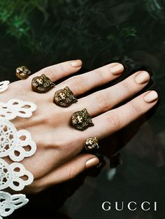 Presenting gifts from the Gucci Garden. Nails and rings from Gucci Gift, High Gloss Nail Lacquer in Metallic Sand with a multi-finger ring in metal featuring feline heads.