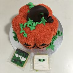 3D Pumpkin cake with surprise candies inside and Halloween's fondant biscuits