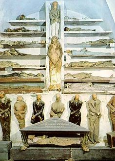 Italy's most ghoulish site, Capuchin Catacombs in Palermo.  This crypt houses thousands of corpses, fully dressed and hung from hooks. The practice began in 1599 when local priests mummified a holy monk and allowed visitors. Soon regular residents of Palermo wanted to be remembered in this fashion. Bodies are arranged by gender and profession; their facial expressions often eerily visible.