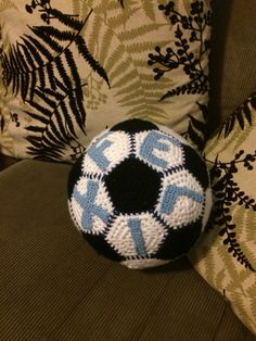 I used the free crocheted soccer ball pattern on Ravelry (see link) & Moogly's free letter patterns.