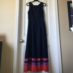 Beautiful Tommy Hilfiger maxi dress, size medium Beautiful navy blue  Tommy Hill figure maxi dress with with orange, coral, purple, black stripes at the bottom. Size medium. Gathered at the waist, floorlength, beautiful satiny material. Perfect for the summer Tommy Hilfiger Dresses Maxi