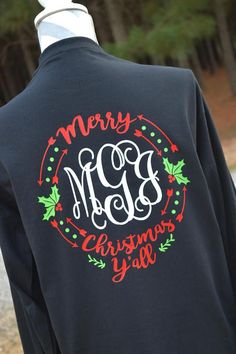 Get ready for Christmas with this monogram Merry Christmas Yall shirt! This shirt features your initials in the popular Vines font in white on the front with design on the back done in red, lime green, and white. This will be done on a long sleeve black t-shirt. Gildan Ultra