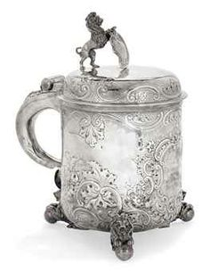 A LARGE LATE VICTORIAN SILVER PRIZE TANKARD IN THE ANTIQUE SCANDINAVIAN MANNER