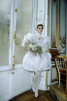 French designer Yves Saint Laurent shows his fall-winter women's haute couture line in Paris. The model is wearing a short puffy white dress with a large headdress. Luxe Wedding, Wedding News, Worst Wedding Dress, Wedding Dresses, Ugly Wedding Dress, Tacky Wedding, Whimsical Wedding, Yves Saint Laurent, Zombie Bride