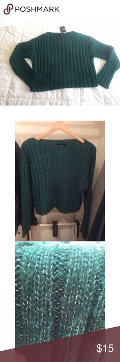 Emerald Knit Sweater It's slightly cropped with an interesting asymmetrical neck line. It leaves your shoulder blades exposed. I really love this rich green color 😍🌲 Did you know that the color green suppresses hunger? Forever 21 Sweaters Crew & Scoop Necks
