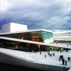 Walk on the roof of the Oslo Opera House that slopes down into the Oslo fjord.