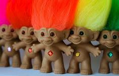 Trolls! I had a bunch of these. I loved them. I don't know where mine went...but I want them back! LoL. I tried looking for some online not too long ago...but I had no luck. =(