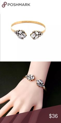 Open Crystal Bangle Multi stone open Crystal and gold plated bangle on size fits all wrist sizes. Jewelry Bracelets