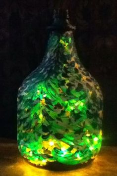 Winter in a bottle-something sparkly for the holidays. i painted an old wine jug and put a strand of 20 lights inside.