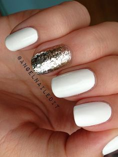 White is the perfect color for winter nails, but a single sparkly finger is the ultimate festive accent.