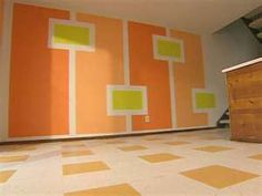 Just draw the attention off the floors and coordinate the colors. perfect.