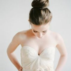 The classic ballet bun is sophisticated, chic and elegant. What better a style to sport on your big day... (Photo Credit: Serephine)