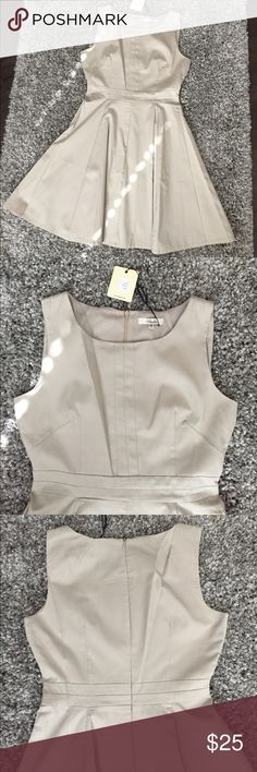 """Khaki Fit and Flare Dress, Size 4, NWT Never worn, NWT! This khaki fit and flare dress is the perfect pice to dress up or down this Spring. So versatile! Fits TTS, falls at knee for me (I'm 5'4""""). Fashion footwear buyer by day, Poshmark purveyor by night! All items ship via USPS within 2 business days. Amelia Dresses Mini"""