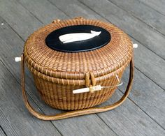 I love my nantucket lightship basket, too bad I can't fit my wallet in it! :-)