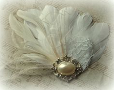 Ivory and white feathered bridal hair fascinator  by kathyjohnson3, $38.00